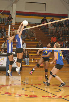 """<div class=""""source"""">Jimmie Earls</div><div class=""""image-desc"""">Washington County senior middle hitter Clare Smith (8) comes up with a big block on a hit by Bethlehem outside hitter Danielle Dorsey (17) in the first round of district playoffs Monday night. WC lost 2-0 to end their 2009 season.</div><div class=""""buy-pic""""><a href=""""/photo_select/3298"""">Buy this photo</a></div>"""