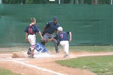 """<div class=""""source"""">Jimmie Earls</div><div class=""""image-desc"""">Washington County's D.T. Yocum (3) slides into home against Campbellsville in the District 5 Little League 9-10-year-old championship game last Tuesday.</div><div class=""""buy-pic""""><a href=""""http://web2.lcni5.com/cgi-bin/c2newbuyphoto.cgi?pub=023&orig=web-dt%2Byocum.jpg"""" target=""""_new"""">Buy this photo</a></div>"""