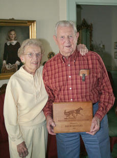 "<div class=""source"">Jimmie Earls</div><div class=""image-desc"">David Goatley and his wife Sara pose with his Hall of Fame plaque presented by the Kentucky Harness Horsemen's Association.</div><div class=""buy-pic""><a href=""/photo_select/4617"">Buy this photo</a></div>"
