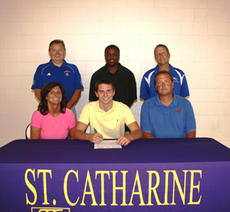 "<div class=""source"">submitted</div><div class=""image-desc"">Washington County graduate Alex Simms, seated center, signs a scholarship offer to play basketball at St. Catharine College. Seated with Simms are his parents, Maria Auberry, left, and Mark Simms. Standing, from left, are Washington County High School Pri</div><div class=""buy-pic""><a href=""/photo_select/2763"">Buy this photo</a></div>"