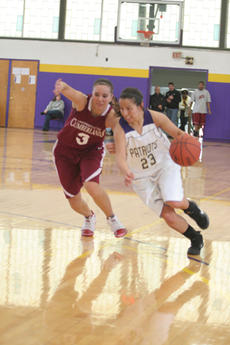 "<div class=""source"">Jimmie Earls</div><div class=""image-desc"">St. Catharine junior guard Emily Caras, left, battles a Midway College defender for the basketball as the Patriots won against the Eagles 71-61 last Tuesday.</div><div class=""buy-pic""><a href=""http://web2.lcni5.com/cgi-bin/c2newbuyphoto.cgi?pub=023&orig=web_caras.jpg"" target=""_new"">Buy this photo</a></div>"