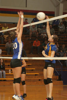 """<div class=""""source"""">Jimmie Earls</div><div class=""""image-desc"""">Washington County's Sarah Colvin (20) goes airborne to block a Bethlehem hit during district playoffs.</div><div class=""""buy-pic""""><a href=""""/photo_select/3299"""">Buy this photo</a></div>"""