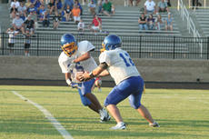 """<div class=""""source"""">Jimmie Earls</div><div class=""""image-desc"""">Commander quarterback Michael Gash hands the ball off to running back Tyler Loving in a scrimmage against North Oldham last Friday.</div><div class=""""buy-pic""""><a href=""""/photo_select/4129"""">Buy this photo</a></div>"""