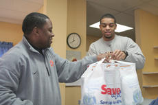 """<div class=""""source"""">Jimmie Earls</div><div class=""""image-desc"""">Patriot head coach J.T. Burton, left, and junior forward Rainier Rickards hand out commodity boxes to local seniors last week.</div><div class=""""buy-pic""""><a href=""""/photo_select/6180"""">Buy this photo</a></div>"""