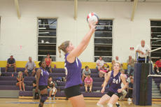 """<div class=""""source"""">Jimmie Earls</div><div class=""""image-desc"""">St. Catharine's Sam Gehler, center, sets the ball for Brittini Schmidt, right, while teammate Shay Mangan, left, looks on in recent volleyball play against Lindsey Wilson College. Although the Pats lost 3-0, they swept three games this past Saturday, winn</div><div class=""""buy-pic""""><a href=""""/photo_select/3282"""">Buy this photo</a></div>"""