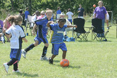 """<div class=""""source"""">Jimmie Earls</div><div class=""""image-desc"""">Aaron Smith, left, watches teammate Alexis Burton use some fancy footwork to move the ball up the field in play for grades 1-3.</div><div class=""""buy-pic""""><a href=""""/photo_select/3488"""">Buy this photo</a></div>"""