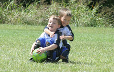 """<div class=""""source"""">Jimmie Earls</div><div class=""""image-desc"""">J.J. Essex, left, and Karson Vanover, right, take some time from Upward soccer last Sunday to turn the game into a wrestling match.</div><div class=""""buy-pic""""><a href=""""/photo_select/3487"""">Buy this photo</a></div>"""