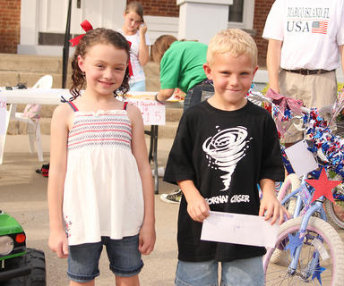 Dalton Carney, right, was the winner of the bicycle decorating contest held Friday evening at the 1816 Courthouse. Second place winner was Isabella Murphy.