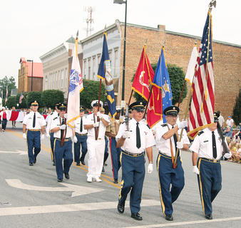 The Marion County Veterans Honor Guard led the way during Friday's parade with the American Flag, as well as the flags of the U.S. military branches.