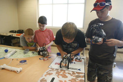 From left, Blake Arnold, Noah George, Ethan Osborne and Nicholas Terrell waited for a robot to begin the obstacle course.