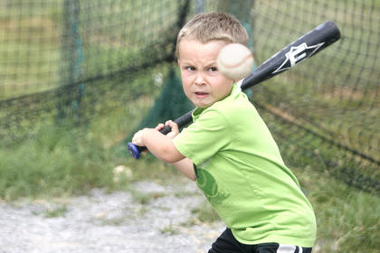 Andrew Wilson took a cut during batting practice at WCHS baseball camp during the summer.