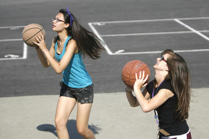 Kimberly Elam, left, and Heather Basham, right, played basketball after breakfast.
