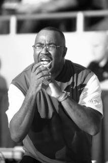 Commanderettes' head coach Bernard Smalley encouraged his team during their 71-52 loss to Owensboro Catholic.
