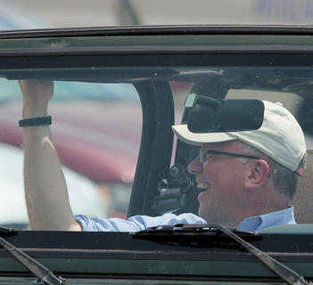 County Attorney Bill Robinson waves to the crowd during the parade.