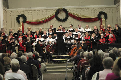 The choir is made up of more 70 members that come from eight counties. Joining them on stage were a group of musicians that played cello, violin, piano and flute.