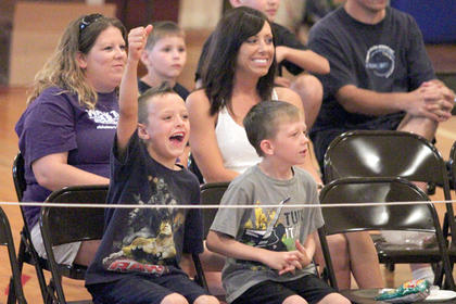 Crowd members were pumped up during the Mackville Mayhem wrestling event on Friday at the Mackville Community Center.