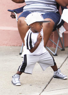 Two-year-old LaMonte Brown of Lebanon, son of LaMonte Brown and Shawna Spaulding, danced and enjoyed the music at the African-American Heritage Festival in Springfield Friday evening.