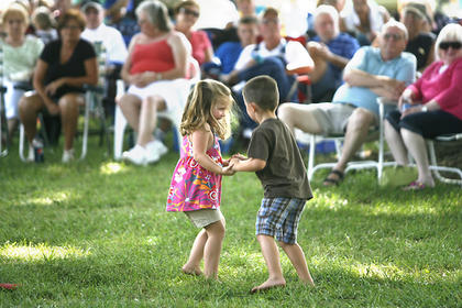 Addi Bartley, 4, left, and Tyler Bartley, 3, right, danced at the Manton Music Jam on Sunday in Manton.