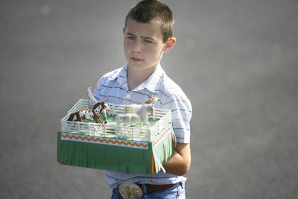 Cole Miller kept his horses fenced in so they wouldn't get out during the parade.