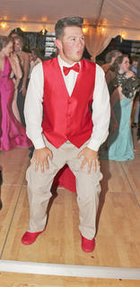 """Tanner Yates shows off his mastery of the """"Electric Slide."""""""