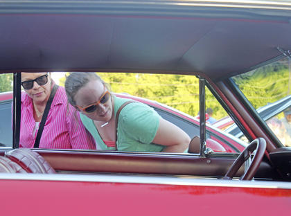 Cindy Kelty (left) and Sara Cannon check out one of the classic cars parked at the event.