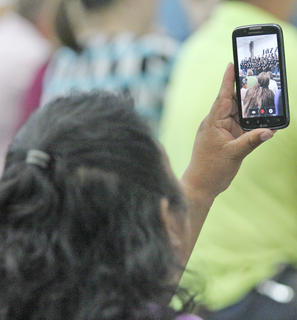 Many crowd members had their cell phones out taking videos and pictures during the event.