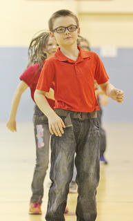 """WCES third-grader Ayden Brown shows off his moves during the song """"Macarena."""""""