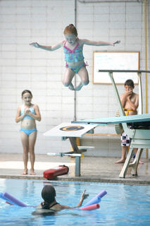 Bryce Smith and Selena Nelson watched as Emma Black took the plunge off the diving board at Boles Natatorium.