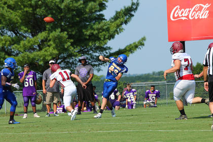Jacob Yates makes a throw down field against Harrison County during the Commanders scrimmage.