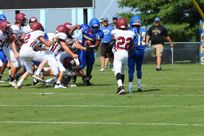 Sophomore running back Mike Ellery drags a gaggle of Harrison County defenders behind him on a carry in Saturday's scrimmage.