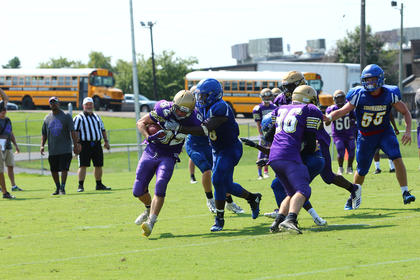 Jbias Dawson wraps up Bardstown's Dylan Eason before the Tiger ball carrier could break into the open field.