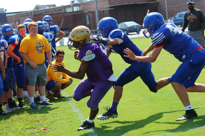 Defenders Matthew Cochran and Justin Durling are able to force Bardstown's runner out of bounds in front of their bench.