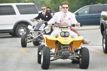 Kyle Curtsinger, Casey Noel, Ethan Robinson and Jennifer Mendoza rolled up to the prom on ATVs.
