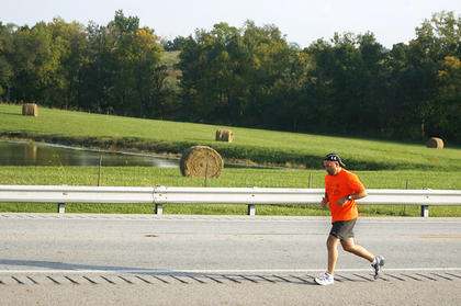 One man made the trip up KY 55 past hay bales and a lake.