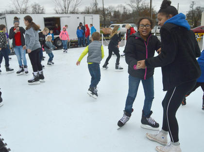 Nastasia Riley, 13, right, helps her sister Chloe, 8, stay upright in the ice skating rink Saturday. After several minutes using her sister for support, Chloe ventured around the rink on her own.