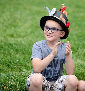 North Washington Elementary kindergartener Lane Ingram sports his custom-made Derby hat, complete with horses and money attached, during the school's annual Kentucky Derby celebration.