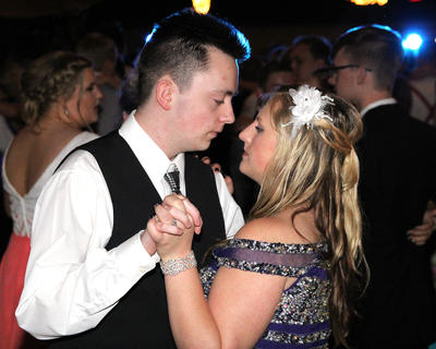 Tanner McGinnis, left. and Tasha Kidwell take advantage of a slow dance.
