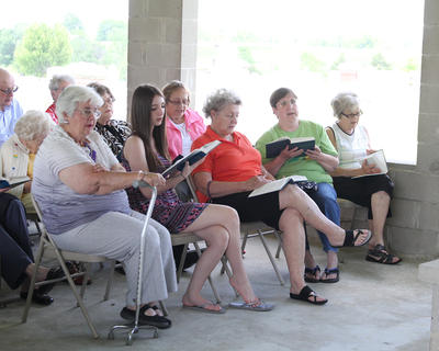 People sing along during a hymn.