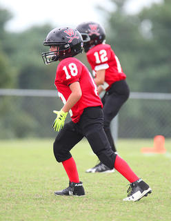 Reece Draper is ready to play defense against Taylor County Saturday in youth league football action.