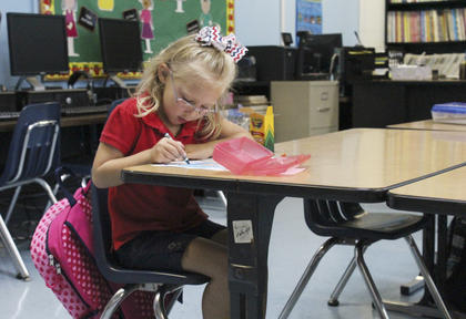 Anna Wren colors during the first day at North Washington Elementary School.