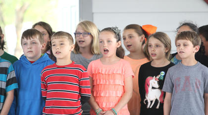 North Washington School students sing a song about the environment.