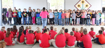 Children performed various musical acts in honor of Earth Day.