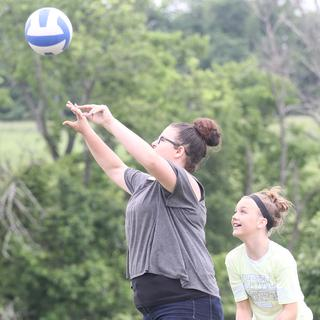 Abigail and Adison Byrd enjoy a game of volleyball with their mother, Mary.