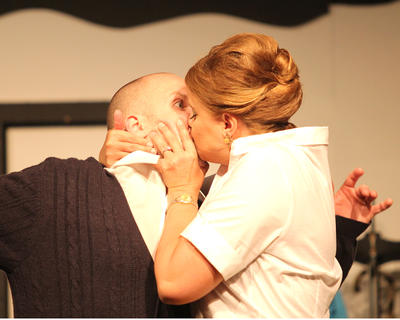 Conway Poteet gets a kiss from Joanne Hopkins.