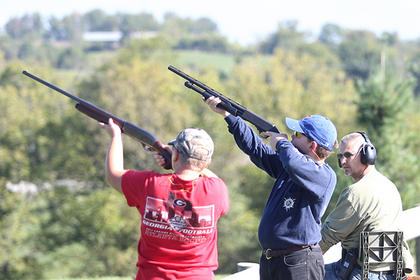 Alex Russell, left, and Harrison Russell take aim at the trap shooting station.