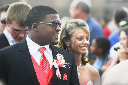 Jordan Wright, left, and Amber Grigsby, right, made their way through the crowd on Saturday before entering the prom.