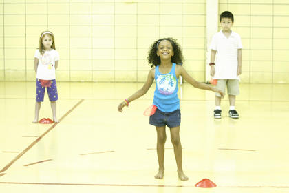 Madeline Lewis, Maleah Dawson and Zhao Peng Lin got in position to play a game in the gym at Washington County Elementary School during summer camp.