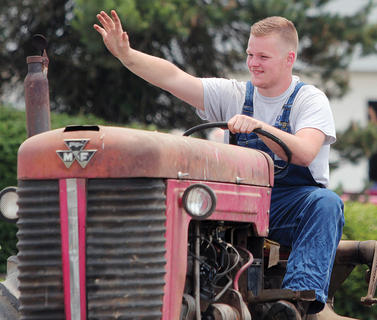 McCade White drives a tractor in the Willisburg Memorial Day Festival.