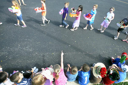 Students checked out Derby projects and attire during a parade.