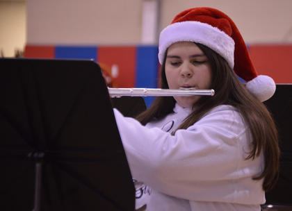 A member of the sixth-grade band performs during the North Washington School Christmas Band Concert, Thursday, Dec. 13.